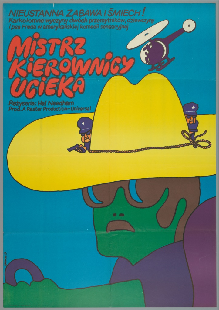 """Cartoon-like, bright image: blue sky, green-skinned man with brown hair and sunglasses, wearing a blue shirt and yellow cowboy hat, holding a blue steering wheel and sitting in purple car seat. On his hat are two crouching police officers, and circling the hat is a helicopter seeking to land. At upper right, in magenta, is the title: """"MISTRZ / KIEROWNICY / UCIEKA"""", surrounded by credits in smaller type."""