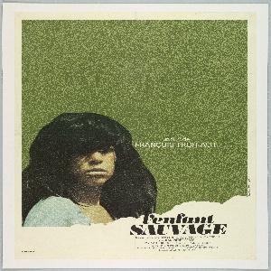 """Against a grass-green background, a photograph of a girl with voluminous brown hair and a stubborn expression; """"torn"""" in the lower right corner. Inscriptions: at center right: """"un film de / FRANCOIS TRUFFAUT"""", and at lower right, the title """"l'enfant / SAUVAGE"""", followed by further credits in smaller type."""