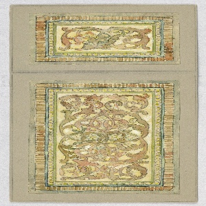Two designs, one smaller and one larger, of scroll pattern with flowers in green with pink, bordered by frame of circles in yellow and stripes in tan.