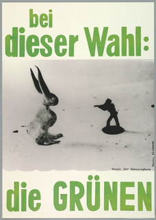 """Election Poster for the Green Party.  Text across top in green reads: """"bei dieser Wahl:"""" with black and white photograph of toy soldier aiming gun at toy rabbit below. Underneath photo, at bottom of poster, text in green: """"die GRUNEN."""""""