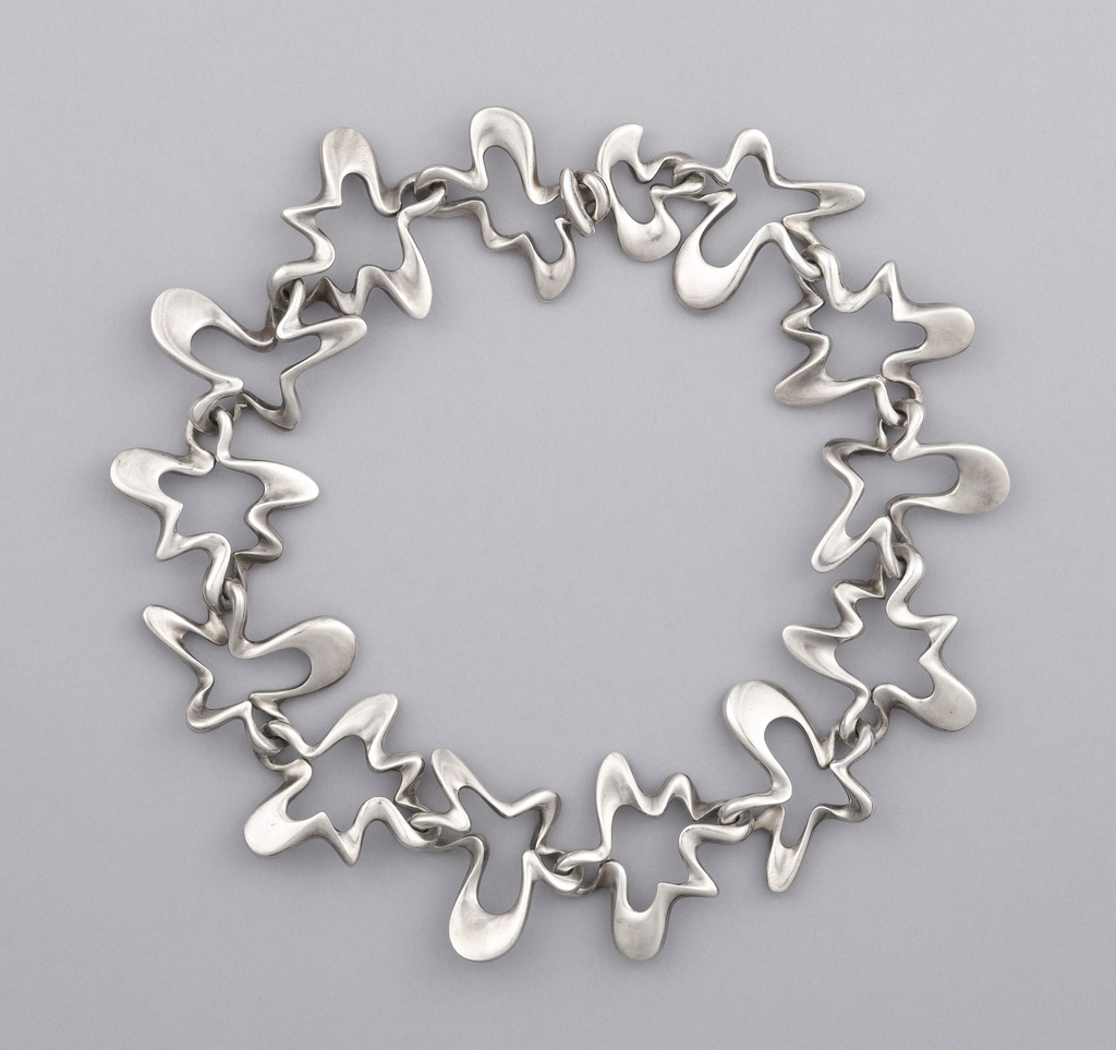 Fourteen cast and individually-shaped large, sterling silver links resembling abstract, amoeba-like forms.