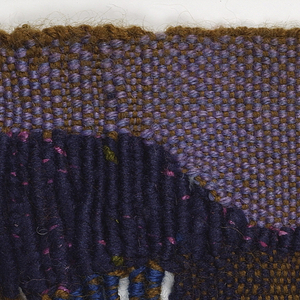 Ochre warp with blue, purple, mauve, and brown wefts. The top is woven solidly across, but ends in five long tabs at the bottom. An area of wrapping occurs near the upper left corner.