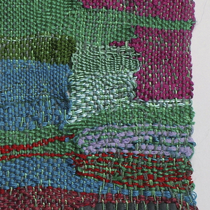 Composition of irregular bands and rectangles in shades of blue, purple, green, brown, and red in varied textures with eccentric weft passages in red.