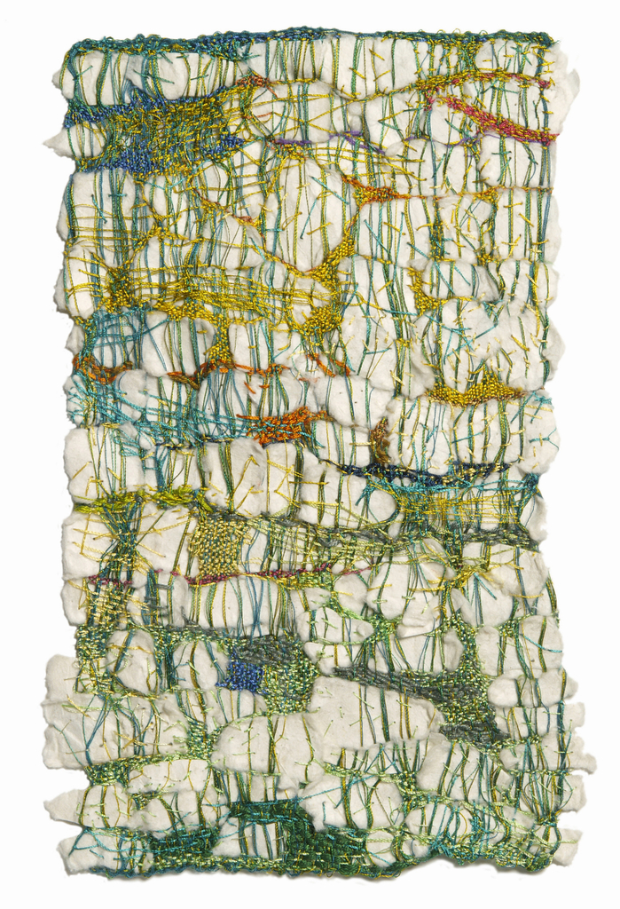 Pieces of softly textured white hand-made paper inserted between green warps, with additional small areas of weaving in green, blue, yellow and orange.
