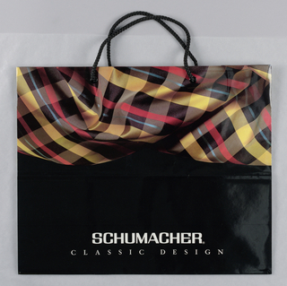 Photo reproduction of plaid fabric on top with store name at bottom.