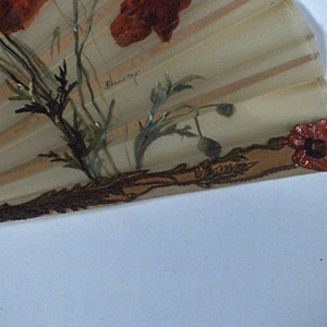 Pleated fan with  white gauze leaf painted on the obverse with a design of poppies. Sticks are carved wood with red and gilded poppies.