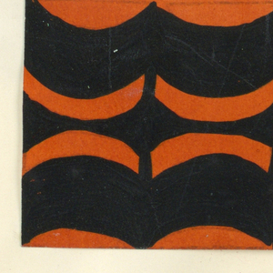 The Monte Zuma textile design consists of rhythmic geometric shapes in the form of alternating curving bands and plant vines in black. This color variation is in black and orange.