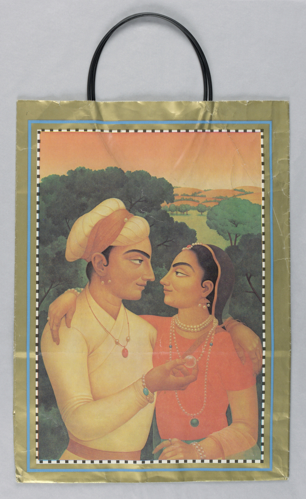 """""""Indian Mughal Art"""" painting of couple in landscape with gold border. Indian man and woman arm in arm facing each other.  Woman in pearl necklace and head accessory while man wearing a turbine.  Man is holding crystal. Black plastic handles."""