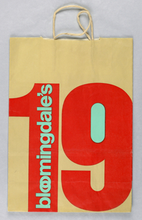 """""""Bloomingdale's 1980"""" in red and aqua on beige without image."""