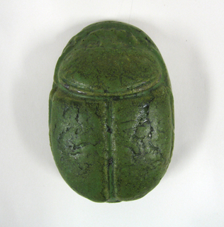 pottery in the form of a scarab, green