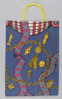 Purple bag.  Recto: International charm bracelet.  Verso: globe.
