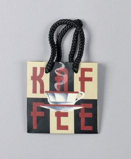 "Tiny bag imprinted with checkered background; six compartments in alternating beige and black.  Each red letter of ""KAFFEE"" is placed in one of  the six compartments.  Central  image shows a steaming white coffee cup and saucer."