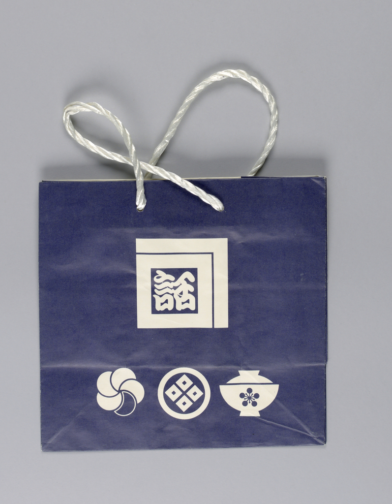 Recto: White rice bowl and two other Japanese motifs on blue background. Verso: Same image with colors reversed.