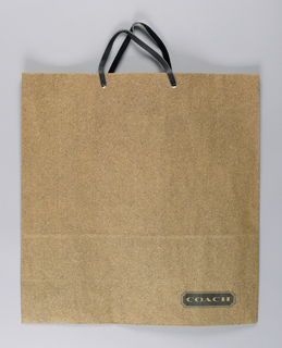"""Dark brown speckled design on brown paper. Recto: """"COACH"""", lower right."""