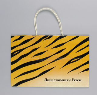 Bag with pattern of tiger stripes in yellow with black, arranged on a diagonal.   Store name, lower right.