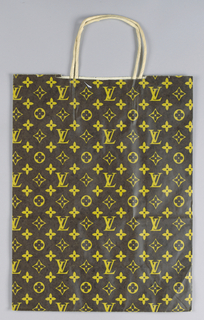"Repeated pattern of gold ""LV"" monogram and clover-like motifs on dark brown background."