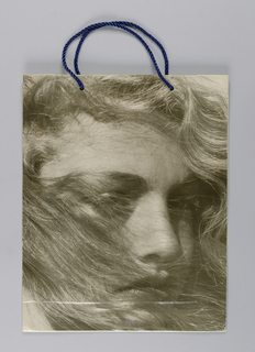 """Recto:""""OBSESSION/ FOR THE HAIR"""" in blue centered at top. Verso: """"CALVIN KLEIN"""" in blue centered at bottom. Black and white photo of woman with windswept hair."""