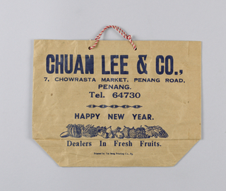 "Recto: ""Chuan Lee & Co."" and address in red on beige paper. Verso: same information in Chinese characters, with two Mickey Mouse figures in red."