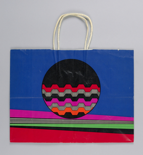 "Spring bag;""Missoni for Bloomingdale's"".  Red, white, black ball on multicolored background."