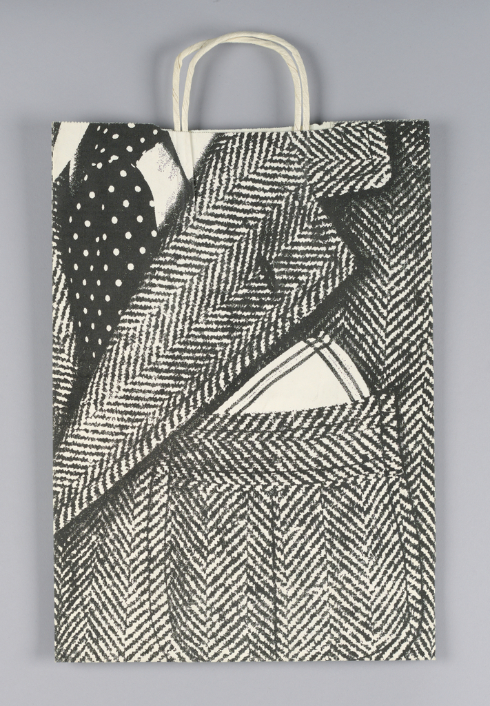 White bag for Bloomingdale's department store with closeup of man's herringbone tweed jacket in black and white, black dotted tie and white handkerchief.