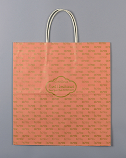 "Salmon- colored bag with Sant Ambroeus logo at center in gold font; ""Sant Ambroeus/ Milano New York"" repeated in small gold font."