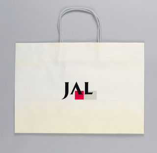 """JAL/ Japan Airlines"" in side panels; logo in black, gray and red on glossy white."