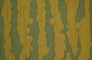 Teal and puce ribbed ground with elongated organic forms, slightly raised, in puce.