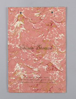 Marbled pink, gold, and white allover pattern, similar to marbled book paper. Store name in gold, center;  3 Paris adresses (e.g.  11 rue Madame  Paris 6e),  lower center.