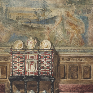Dominating the wall elevation in the center of this view is a large Flemish tapestry showing a classical temple on the left, trees in the background, and barely visible figures in the foreground. A seventeenth century Flemish cabinet-on-stand holding a display of Chinese porcelains is flanked by settees upholstered in burgundy velvet. The ceiling border is stuccoed in a classical mask and swag design. A porphyry column on the right delineates a curtained doorway. The overdoor broken pediment and urn decorations on the left follow the classical vocabulary of this elevation.