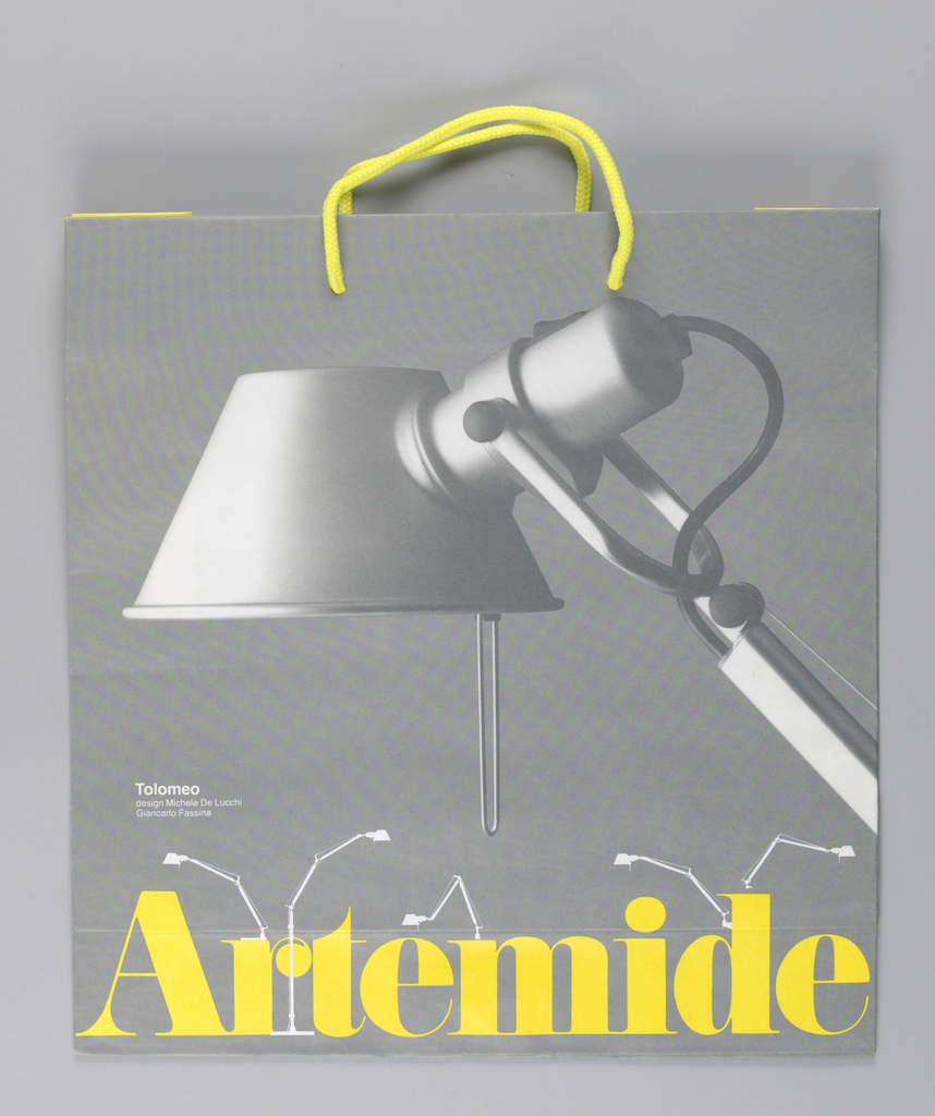 Firm and object name;  image of metal desk lamp; names of object's designers, Michele De Lucchi and Giancarlo Fassina.