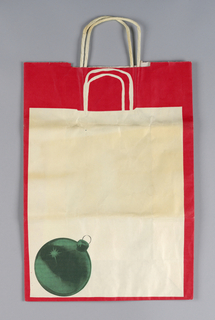 Christmas ornament on picture of shopping bag without text.