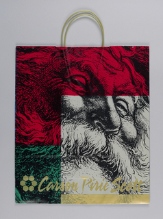 Recto: Red, green, white with black block print of Santa Claus's head. Verso: Doll, rocking horse. Store name on Recto and Verso and in both side panels.