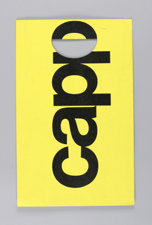 """CAPP"" in black against lemon yellow extends vertical length of bag."