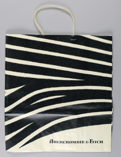 Photo-lithography reproduction of  black and white striped fur.  Store name in red.