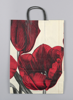 White bag with large red tulips.