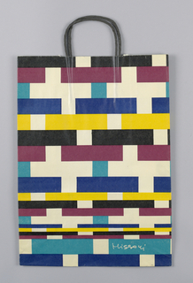 Bag with pattern of black, white, maroon, turquoise, yellow, and dark blue rectangles.