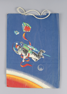 "Blue bag with Santa, dressed in space suit, flying over earth. Right side panel: ""Christmas At the Dawn of a New Decade,"" in electronic type."