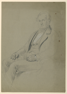 Man seated in an armchair, facing toward the left. His hands resting on his legs, and his feet not shown.