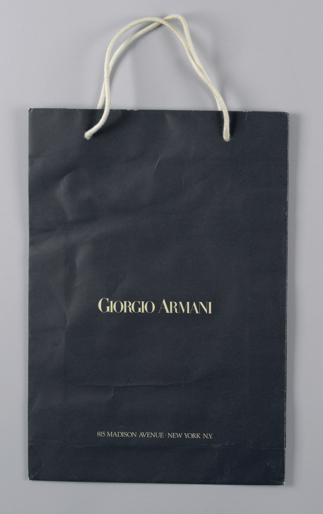 "The text ""Giorgio Armani / 815 Madison Avenue New York, NY"" in white on dark blue satin finish paper."