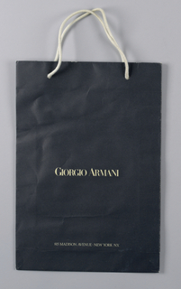 "The text ""Giorgio Armani / 815 Madison Avenue New York, NY"" in white on dark blue satin finish paper."