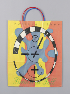 "Recto: ""Time Will Tell..."" across top.  Stylized clock with purple puzzle piece in blue at center. Verso: White ""S"" superimposed. ""Say"" and ""Yes"" on side panels."