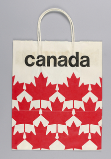 """""""Canada"""" in black on white background; red maple leaves middle to bottom of bag."""