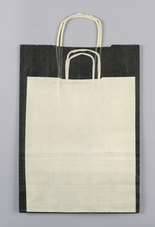 Black and white bag with white drawing of shopping bag.