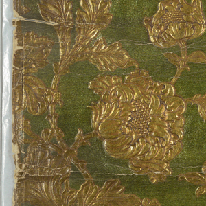 Embossed realistic interpretations of large chrysanthemums and leaves, on serpentine stems, printed in metallic lime green and metallic gold.
