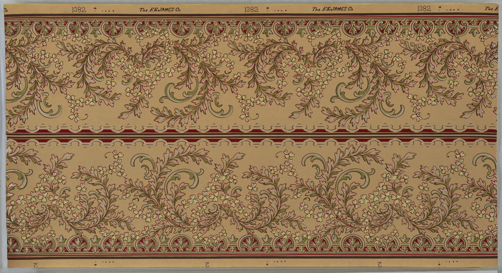 "Borders printed two across. Scrolling foliage with foliate vining. Bottom band of palmettes and top band of scrolls, dashes and dots. Printed on tan ground in green, red, brown-green, light green and white liquid mica. Printed in selvedge: ""the F.E. James Co."" pattern number ""1382"" ; ""2"""