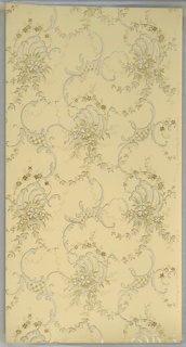 "Overall waving scroll pattern connected by floral vining, foliate swag, and small clusters of flowers. Ground is cream. Printed in light beige, mica golds, light blue, and white mica.  Printed in right selvedge: ""Cresswell and Washburn 0.628 Phila."""
