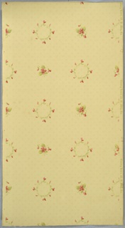 Alternating small floral wreaths and small floral bouquets, with beige ground. Background has four-dot pattern. Printed in pinks, greens, and tan.