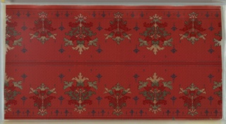 """Art nouveau / mission style. Border printed two across (mirror). Alternating large and medium stylized floral bouquets between which are stylized single-flower motifs. Connected at bottom by floral motif band. Background of small trellis composed of dashed, dots and curved lines.Printed on red ground in dark reds, dark green, blue, yellow liquid mica and teal liquid mica. Printed in selvedge: """"Exclusive Design"""" """"S.A. Maxwell & Co. New York & Chicago."""""""