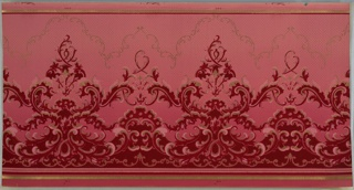 Alternating large and small foliate medallions foliate scrolls, scrolling foliage and scallops. Forms are enframed on top by scrolls and connected on bottom by a band of scrolls with floral motif. Background of thin undulating lines and dots. Printed on ground that shades dark pink to light pink (bottom to top) in dark red, red, light pink and metallic gold.