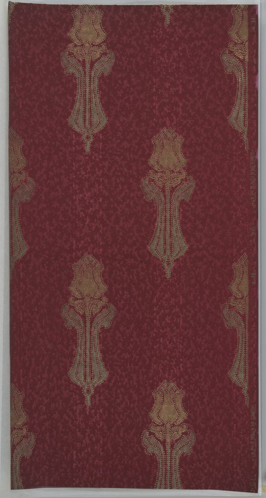 Individual, stylized tulips (with stem) made of grid and dot (beading) patterns. Background has red and pink grid, dot, and smudge pattern with bands of floral motifs. Ground is dark red. Printed in pinks, reds, gold mica and green mica. Slight water damage. 